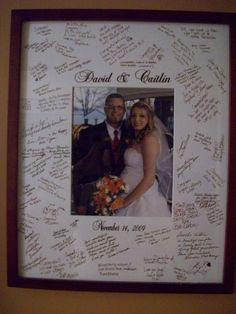 Guest Book alternative, engagement/wedding picture of couple in middle and sign on outside