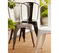Old Metal Cafe chairs painted and repurposed for patio chairs
