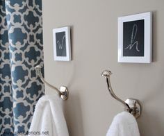 Towel hooks ~ add small frames above the hooks, spray paint white and paint the glass with chalkboard paint to create a W (for wife) and H (for husband).