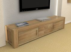 The Wooden Furniture Store's Atlas Oak widescreen television cabinet with doors has a clean, modern design for your living room.