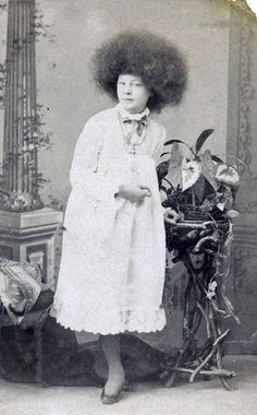 """""""In the 1860s P. T. Barnum exhibited women as Circassian beauties. They wore a distinctive hair style, which had no precedent in earlier portrayals of Circassians, but was soon copied by other performers, known as """"moss haired girls"""".    """"These were typically presented Turkish sexual slaves who had escaped the harem for freedom in America.    """"Their distinctive hairstyle were held in place by the use of beer.""""    - Wikipedia"""