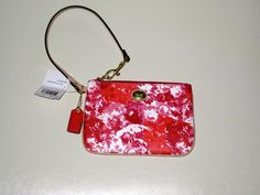 'BNWT COACH Peyton Floral Print Small Wristlet' is going up for auction on Tophatter.