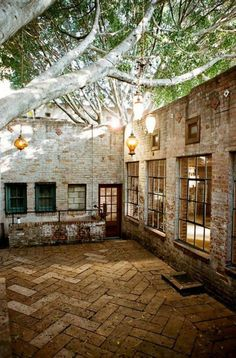 I want a house with a courtyard...more chic and wonderful than a porch or patio