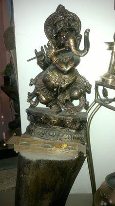 Krishna roop wooden Ganesha on a tree stump Carma