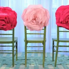 How about this pretty alternative to the usual fabric sash chair decorations? Giant fabric roses.