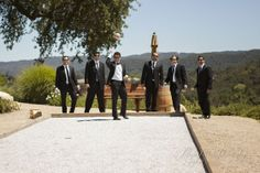 Carlos and his groomsmen calm pre-wedding jitters with a game on Denner Vineyard's own bocce court. Check out the oak-studded hills in the distance.