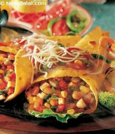Let's+journey+to+Mexico.....+.+The+land+of+tacos+and+tequila.+This+sizzler+is+a+fiery+combination+of+veggie+filled+tortillas+served+with+a+stir-fry+and+spicy+papri+flavoured+mashed+potatoes.+