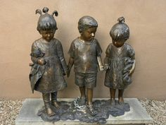 """Three Bronze Children"" - photo by Charles Yurchak (Cha Li), via Flickr; in New Mexico"