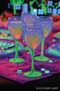 Plastic goblets go glowingly green with just a simple paint job! Apply thorough coats of glow-in-the-dark paint. The number of coats will determine the intensity of the glow. Just be sure to stick to the stems, since the paint shouldn't touch what your guests are drinking.