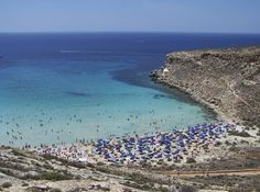 Rabbit Beach on the island of Lampedusa, Sicily, draws beach bums in hordes
