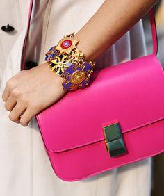 bright pink Celine bag and a Versace bracelet