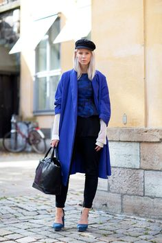 A newsboy cap and cool mix of cobalt and black make for a stylized result.