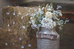 Milk churn with wedding flowers  - Christopher Ian Photography