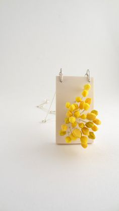 Pollen (pendent) in polymer clay by Céline Charuau