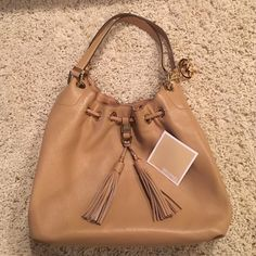 Beautiful and buttery leather Michael Kors bag. Excellent condition! Shiny gold hardware with tassels. Very clean interior. Michael Kors Bags Shoulder Bags