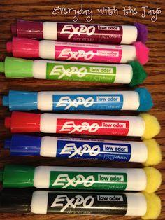 Hot glue Pom poms to dry erase markers. Instant eraser! Dark colors work best. :)
