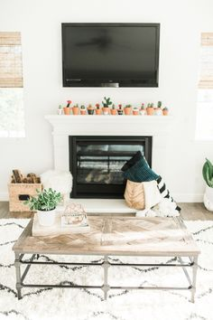 Chic southwest inspired TV room: http://www.stylemepretty.com/living/2016/01/25/modern-bohemian-california-home-tour/ | Photography: Daphne Mae - http://www.daphnemaephotography.com/
