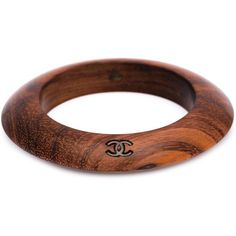 Chanel Vintage logo bangle ($1,180) ❤ liked on Polyvore featuring jewelry, bracelets, brown, vintage bangle, hinged bracelet, wood bangle, chanel bangles and bangle jewelry