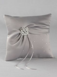 The platinum celebration ring pillow has matte bridal satin that is softly draped and finished with a romantic large rhinestone piece accented with sophisticated pearls and genuine Swarovski crystals.  Kim's Bridal, Keywords:  #michiganeventrentals #michiganbridalshop #weddingrentals #weddingaccessories #kimsbridal Follow Us: http://www.kimsgiftbaskets.com/ ... https://www.facebook.com/KimsGifts