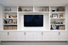 A wall of built-ins for a family room media center. – Addition on Three Floors – Board & Vellum A wall of built-ins for a family room media center. – Addition on Three Floors – Board & Vellum Built In Shelves Living Room, Living Room Wall Units, Home Living Room, Living Room Designs, Living Room Decor, Tv Wall Units, Built In Tv Wall Unit, Tv Built In, Tv Wall Shelves