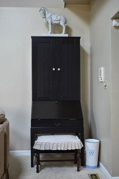 Ikea computer armoire with restoration hardware glass knobs and slip covered bench. Monograms 'n Mud Family Room