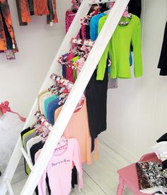 Merchandising tip: The right hanger can partner with apparel to make attractive displays that help you close the sale. Amore Dancewear in Saginaw, MI hand-covers its hangers with patterned fabric. (Photo courtesy of Amore Dancewear)