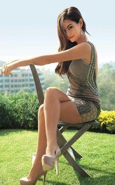 Crossed legs in a mini dress and sky high heels