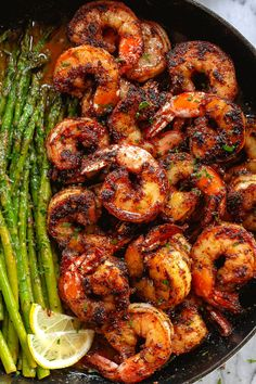 Blackened Shrimp and Asparagus Skillet Minutes) - - Blackened Shrimp and Asparagus Skillet – These delicious blackened shrimp with asparagus are the perfect versatile and fast weeknight meal. Flavorful, juicy shrimp team up with crisp-tender a…. Shrimp Recipes For Dinner, Salmon Recipes, Seafood Recipes, Cooking Recipes, Meal Recipes, Good Recipes For Dinner, Cooked Shrimp Recipes, Smoked Sausage Recipes, Indian Chicken Recipes