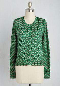 Fine-tune a ditty to showcase the delightful style of this kelly green cardigan! Animated with blush and burgundy daisies and fastened with shell buttons, this spirited sweater has what it takes to bring a tune to every heart!