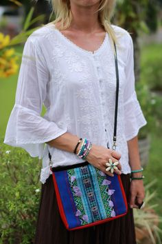 Such a cute little leather bag with vintage fabric and gorgeous boho jewelry. #ethniclanna
