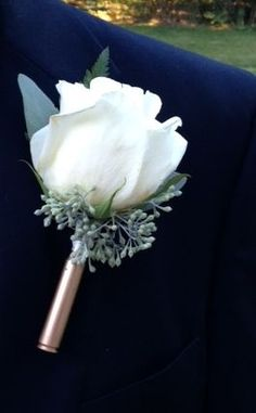 rifle shell boutonniere, wedding flowers for guys, outdoor wedding, outdoors men, rifle shell with flower, groom that is a hunter, rustic wedding, hunting wedding, flowers, unique idea for the grooms flowers