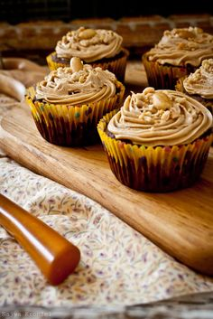 Peanut Butter and Chocolate Cupcakes - unsalted butter- sugar - brown sugar - 2 extra large eggs - pure vanilla extract - buttermilk - sour cream - brewed coffee - flour - cocoa powder - kosher salt - chopped peanuts
