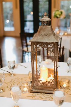 great lantern centerpieces, do the runner in a fall color, red or purple or sheet music