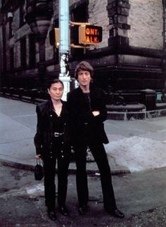 John Lennon & Yoko Ono On The Corner Of The Dakota