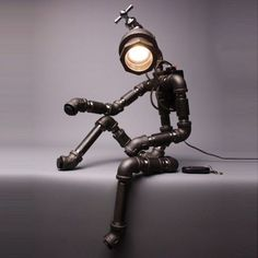 Humanoid lamp made from old pipes. Cool idea. #lighting #art Lampe Industrial, Lampe Metal, Industrial Style, Industrial Lighting, Industrial Irons, Pipe Furniture, Industrial Furniture, Led Art, Lampe Steampunk