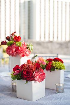 Red centerpiece. JCG Events wedding