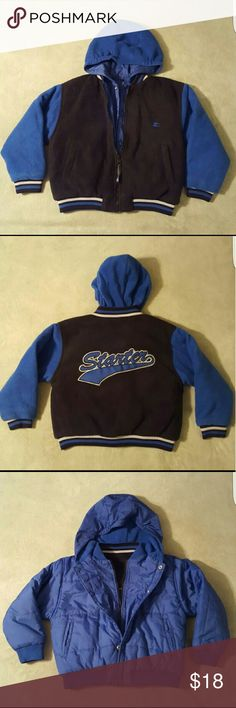 BRAND NEW Reversible YOUTH Starter Jacket w/hood BRAND NEW without tags, never worn, reversible Starter jacket with hood. Features zipper and snap closures, 2 front hip pockets, and ribbed cuffs and collar. One side is black fleece, and is made of 100% polyester, with the Starter logo on the back and left front breast. The other side is royal blue, and is made of 100% nylon, with the Starter logo also on the left front breast. SIZE: YOUTH SMALL (8). SMOKE-FREE home. Starter Jackets & Coats