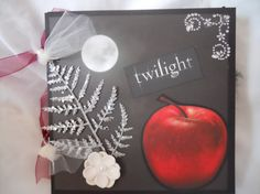 """This is a great Twilight themed mini album with lots of room for photos and journaling. Scrapbook measures 8"""" x 8"""" and features 10 premade pages ready for you to add your photos. Please use the """"visit website"""" button to purchase this mini album or to view journals, scrapbooks, and smash books in stock. Please also visit   https://www.flickr.com/photos/islandlillydesigns/sets to view our portfolio for design inspiration. Album designed by Island Lilly Designs N.Y."""
