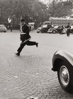 Robert Doisneau - Traffic Policeman in Paris (Stiff Run). 1950's. S)