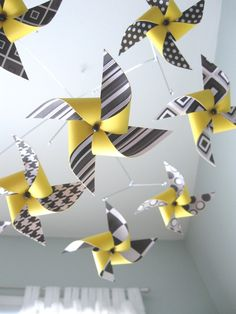 LOVE LOVE LOVE the idea of a pinwheel mobile!  bright colors can face the baby AND it can be DIY!!