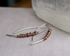 Hey, I found this really awesome Etsy listing at https://www.etsy.com/listing/217690897/sterling-silver-copper-wrap-earrings