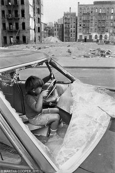 Martha Cooper: Playing in an abandoned car. Lower East Side, NYC, Early 80's