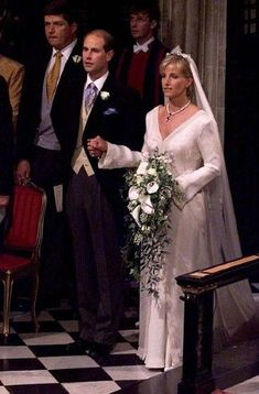Prince Edward, the youngest son of Britain's Queen Elizabeth II and his bride Sophie Rhys-Jones, walk down the aisle at their June 1999 in St George's Chapel, Windsor Castle. Sophie Rhys-Jones, is now the Countess of Wessex. Royal Wedding Gowns, Royal Weddings, Wedding Dresses, Wedding Vows, Lady Louise Windsor, English Royal Family, Elisabeth Ii, Royal Brides, English Royalty