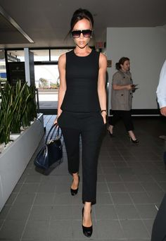 VB style.  Cropped slim black pant and tailored sleeveless top.  Simple and chic.