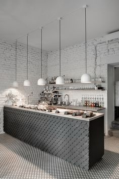 Painted brick walls ⎮ tiles ⎮ pendulum lights ⎮ Floor