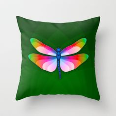 Paper Craft Dragonfly Throw Pillow - Brilliantly colored dragonfly with open wings against a green leaf pattern background
