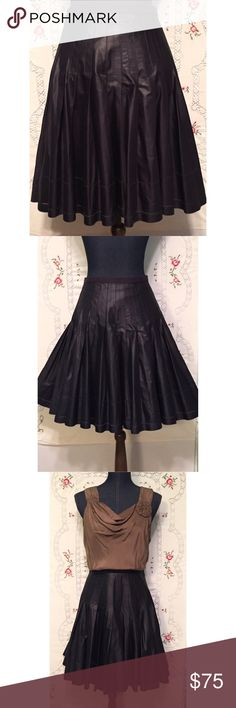 """Ted Baker London Full Skirt Grosgrain Waist NWOT NWOT skirt by Ted Baker London is a very full cotton/poly blend. Machine washable. Size 3 translates to an American Medium. The color is somewhere between black, dark purple and raisin and really stunning. Length 21"""" and waist measures 16"""". Ted Baker London Skirts"""