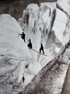"Late Victorian mountaineers, including a lady fully dressed and corseted, cross a crevasse in the Alps, 1900 (from Getty Images' book ""Decades of the 20th Century—1900s"" by Nick Yapp, scanned by WeirdVintage)."