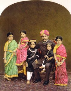HH Chamaraja Wadeyar of Mysore, a handsome man whose family has been shown here before, sits with his five beautiful children.