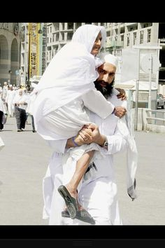 Son Carrying Mother to Friday Prayers (Madinah, Saudi Arabia)